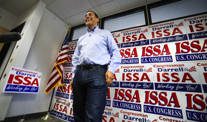 Rep. Darrell Issa answers reporters questions at his Oceanside campaign headquarters.