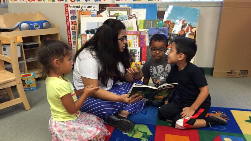 Marriage and Family Therapist Intern Reshma Patel working with children at an Easter Seals Child Development Center.