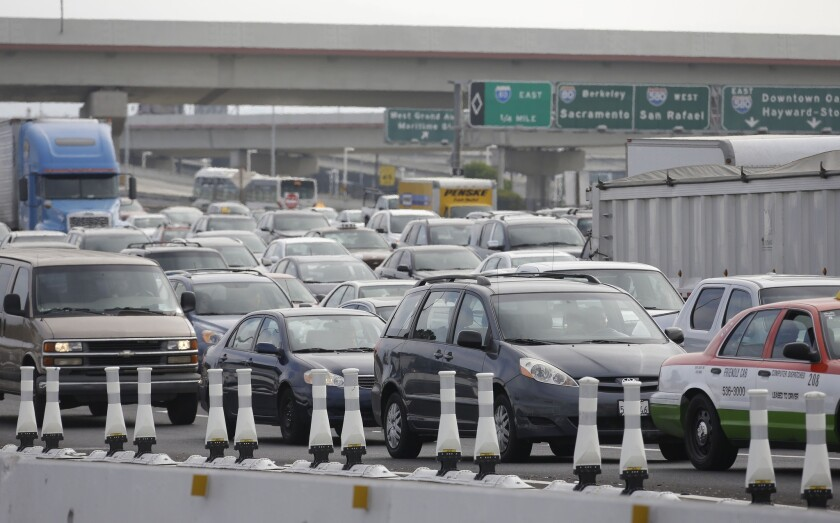 With a BART strike underway in October, late-morning traffic backed up near the San Francisco-Oakland Bay Bridge toll plaza. Strikes such as that one are hurting the public's perception of organized labor, according to a poll.