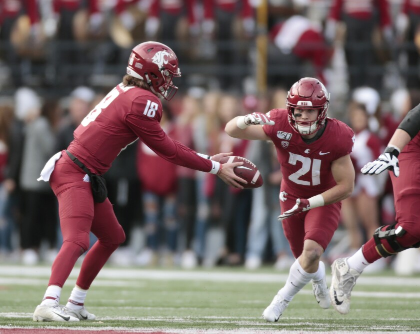Washington State quarterback Anthony Gordon prepares to hand off to Max Borghi during the first half against Stanford on Nov. 16, 2019, in Pullman, Wash.