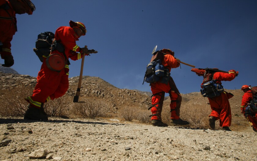 Inmate fire crews from Northern California prepare to battle the Silver fire in Riverside County in August 2013.