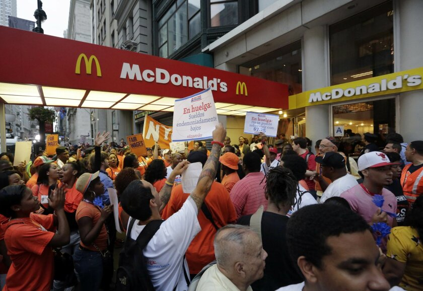 Protesting fast-food workers demonstrate outside a McDonald's restaurant on New York's Fifth Avenue. Labor unions in about 100 cities demanded fast-food workers receive $15 an hour, or about double the federal minimum wage of $7.25 an hour.