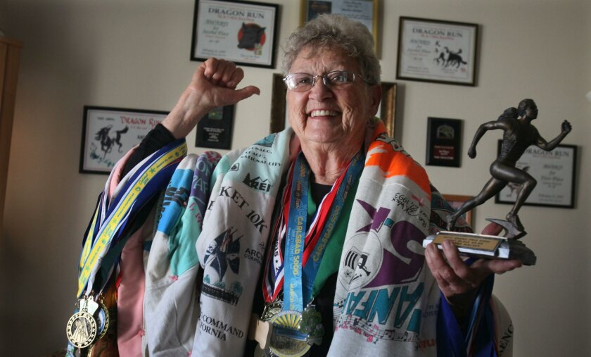 Martha Walker, 80, has been running for decades, and has amassed countless medals, trophies, plaques and other accolades.