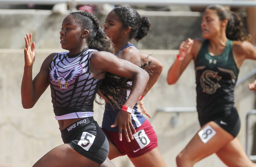 Madison sophomore Aysha Shaheed (left) wins the 200-meter dash Saturday in 24.16 seconds, best in the San Diego Section this spring. Shaheed also finished first in the 100-meter race.