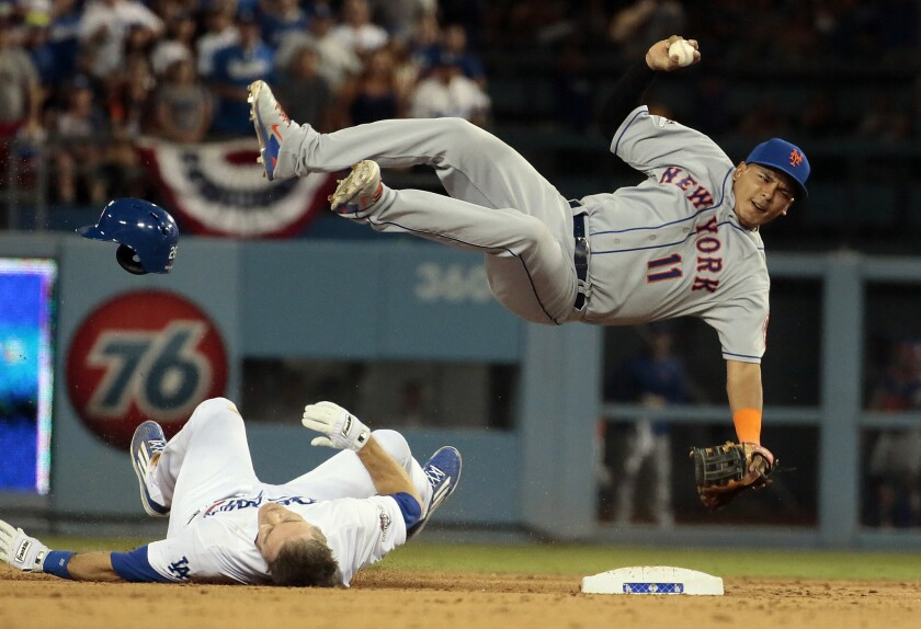 The Dodgers' Chase Utley upends Mets infielder Ruben Tejada at second base in Game 2 of the National League division series.