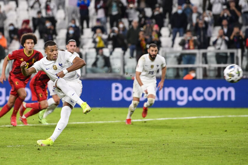 France's Kylian Mbappe scores his team's second goal from the penalty spot during the UEFA Nations League semifinal soccer match between Belgium and France at the Juventus stadium, in Turin, Italy, Thursday, Oct. 7, 2021. (Fabio Ferrari/LaPresse via AP)