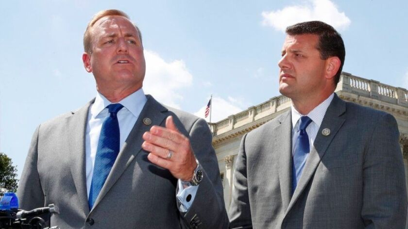 Rep. Jeff Denham (R-Turlock), left, speaks next to Rep. David Valadao (R-Hanford) during a news conference on Capitol Hill.