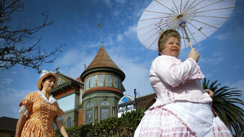 June 27, 2015, SAN DIEGO, CA | Dressed in 1880s attire, Diana Murphy, left, and Linda Wright, right,