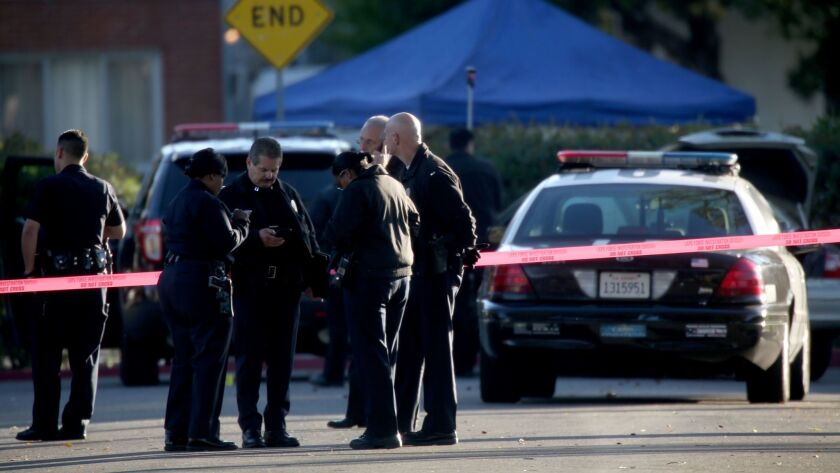 Investigators work the scene of a deadly 2015 shooting by a Los Angeles police officer in Burbank. Prosecutors announced Tuesday that they would not file criminal charges against LAPD Officer Brian Van Gorden, who shot and killed Sergio Navas after a car chase.
