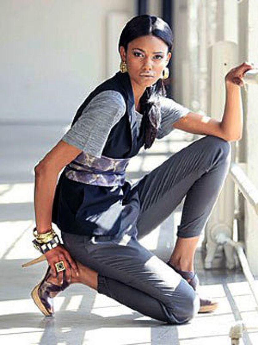 IT'S A WRAP: Kova & T T-shirt, $85 at Saks Fifth Avenue, Beverly Hills; Theory vest, $295 at Neiman Marcus, Beverly Hills; Helmut Lang pants, $290 at Helmut Lang, L.A.; Elie Tahari obi belt, $198 at Elie Tahari boutique, Las Vegas; Lia Sophia gold bangles, $275 each, ring, $175, and earrings, $250 at www.liasophia.com; CC Skye wooden bangle, $80 at www.ccskye.com; Nine West shoes, $89 at ninewest.com.
