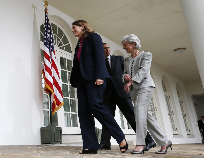 President Obama walks with Sylvia Mathews Burwell, left, whom he has nominated as secretary of Health and Human Services, and Kathleen Sebelius, who is stepping down from that post.