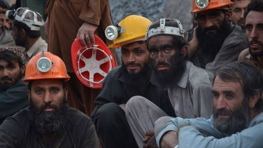 Coal miners wait for the recovery of their colleagues in Quetta, Pakistan.