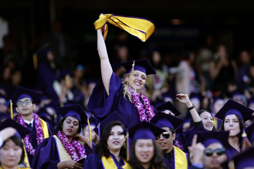 In this photo taken Friday, May 27, 2016, Jillian Sobol show her excitement during her college graduation ceremony at AT&T Park in San Francisco. More than 30 years after she was abandoned as a newborn in a dorm at San Francisco State University, Sobol has graduated from the school where she began
