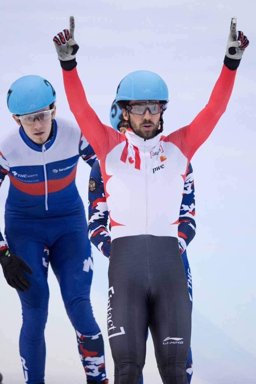 Canada's Charles Hamelin , front,  celebrates while  crossing the finish line   during   the men's 500 m final at the ISU Short track World Cup event in Dresden, Germany, Sunday Feb. 7, 2016. (Sebastian Kahnert/dpa via AP)
