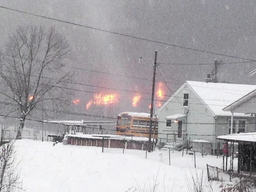 A train derailment in West Virginia started a fire that destroyed one house, and may have contaminated a river with crude oil.