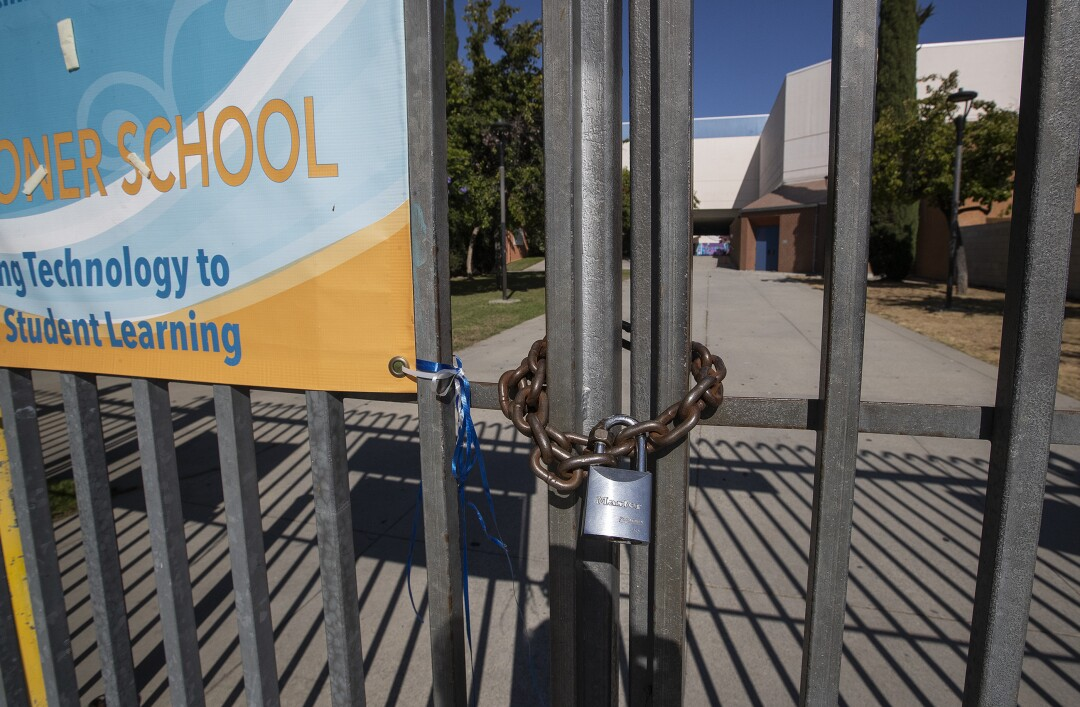 A gate at Los Angeles High School remains locked.