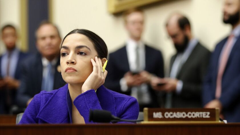 In this Wednesday, April 10, 2019, file photo, Rep. Alexandria Ocasio-Cortez, D-N.Y., listens during a House Financial Services Committee hearing with leaders of major banks on Capitol Hill in Washington.