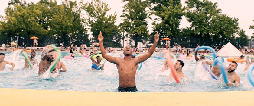 A crowd of people partying in a giant swimming pool