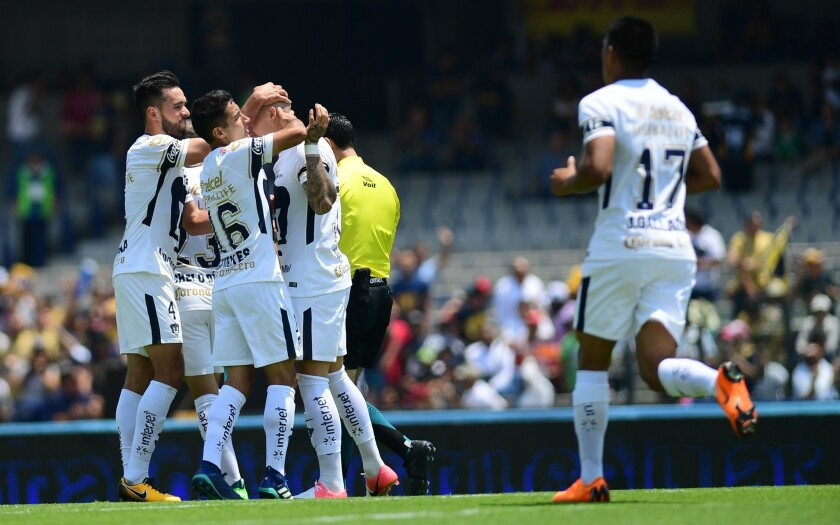 Pumas' Chilean forward Nicolas Castillo (2-R), celabrates with teammates after scoring a goal, during their Mexican Clausura tournament football match against Puebla at the Olympic stadium in Mexico City, on April 15, 2018.