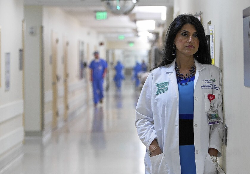 """Soudi Bogert, a veteran ICU nurse at St. Joseph Hospital in Orange, is among those who treated beating victim Kim Pham. """"No one knew why she was here and that was fine,"""" she said. """"We had our job to do."""" But it was more than a job with Pham. Over the days to come, nurses not assigned to her would check in on her, hugging one another in the hallways for support."""