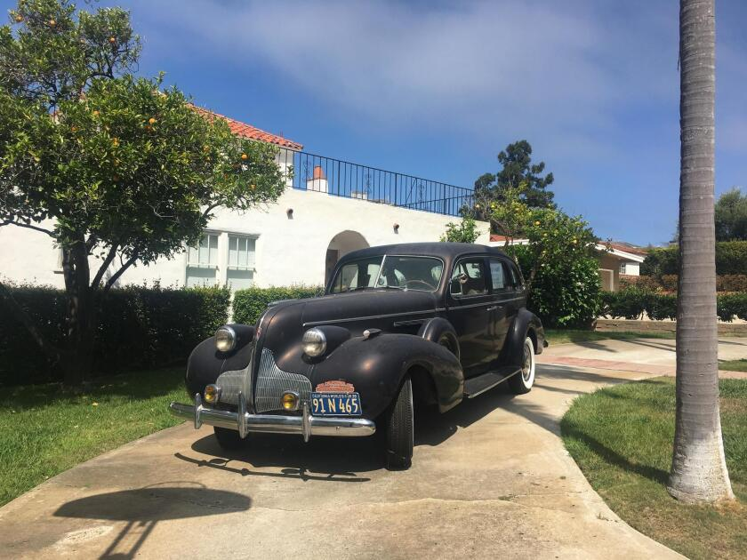 Walking on Bellevue Avenue in the Bird Rock area on Aug. 9, I thought I fell through a crack in time! Seeing this classic car and classic Spanish-tiled home — even with a classic California palm tree — left me wondering if Bogie and Hepburn were sauntering about?