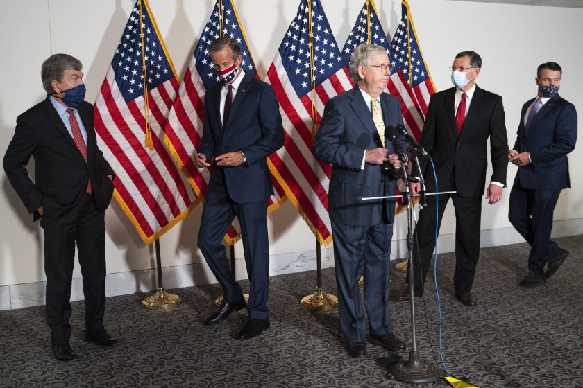 Senate Majority Leader Mitch McConnell of Ky., center, approaches the microphones accompanied by, from left, Sen. Roy Blunt, R-Mo., Sen. John Thune, R-S.D., Sen. John Barrasso, R-Wyo., and Sen. Todd Young, R-Ind., at the start of a news conference, Wednesday, Sept. 9, 2020, on Capitol Hill in Washington. (AP Photo/Jacquelyn Martin)