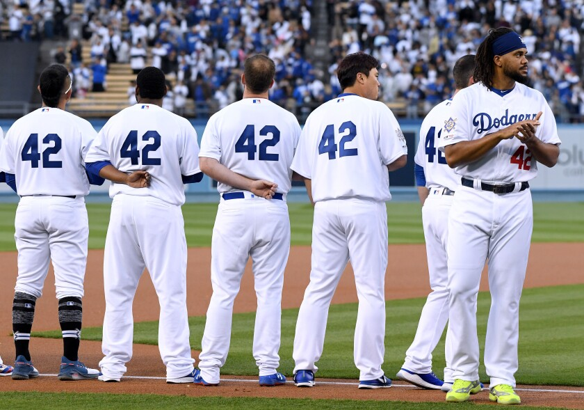 Kenley Jansen of the Los Angeles Dodgers lines up for the national anthem before a game against the Cincinnati Reds on Jackie Robinson Day 2019