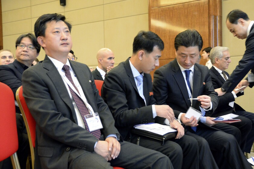 """Jo Chol Su, left, director of the North Korean Foreign Ministry's North American Affairs Department, attends an international nuclear nonproliferation conference in Moscow on Nov. 8, 2019. North Korea has warned the U.N. Security Council against criticizing the isolated country's missile program, in a statement Sunday that included unspecified threats against the international body. On Sunday, Oct. 3, 2021, Jo Chol Su, a senior North Korean Foreign Ministry official, warned the U.N. council it """"had better think what consequences it will bring in the future in case it tries to encroach upon the sovereignty"""" of North Korea. (Kyodo News via AP)"""