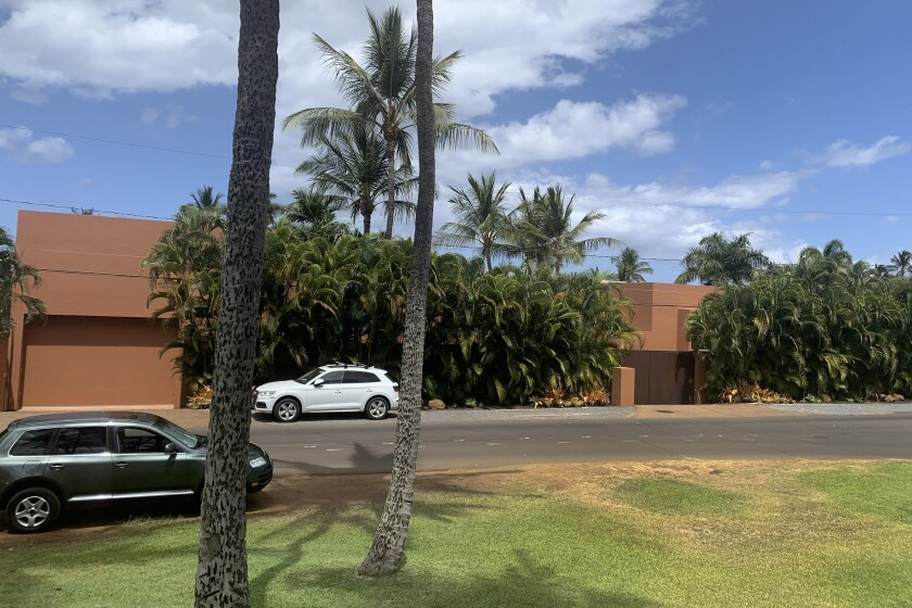 Part of a Maui mansion is seen from a street in Kihei, Hawaii on Thursday, Aug. 5, 2021. The $45-million cash sale of the eight-bedroom house reflects a hot real estate market where the median price of a Maui home topped $1.1 million in June. (J.D. Kim via AP)