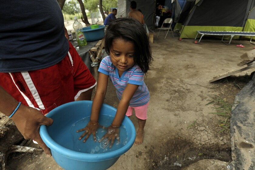 Migrants wash their clothes at the Matamoros refugee camp.