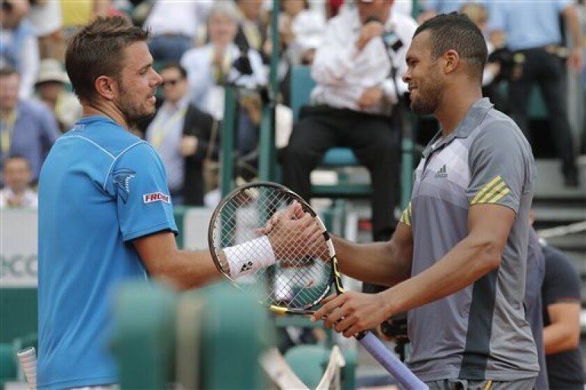 France's Jo-Wilfried Tsonga, right, shakes hands with Stanislas Wawrinka of Switzerland after winning his quarter final match of the Monte Carlo Tennis Masters tournament in Monaco, Friday, April 19, 2013. (AP Photo/Lionel Cironneau)