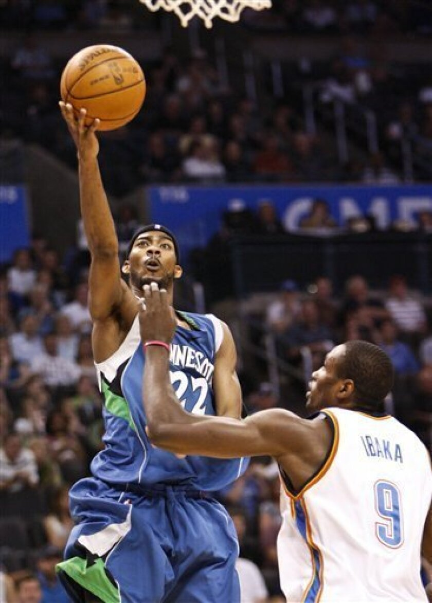 Minnesota Timberwolves guard Corey Brewer (22) goes up for a basket as Oklahoma City Thunder's Serge Ibaka (9) defends in the second quarter of an NBA basketball game in Oklahoma City, Sunday, April 4, 2010. (AP Photo/Alonzo Adams)