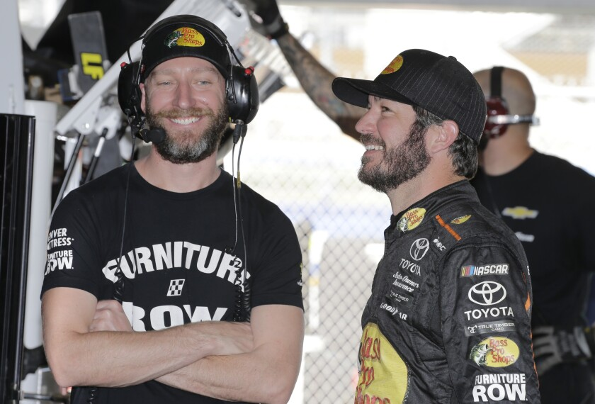 FILE - In this Nov. 17, 2017 file photo Martin Truex Jr., right, smiles with crew chief Cole Pearn before practice for Sunday's NASCAR Cup Series auto race at Homestead-Miami Speedway in Homestead, Fla. Pearn is leaving NASCAR to spend more time with his family. Pearn won the 2017 championship with Truex Jr. and the two were second in the standings the last two years. (AP Photo/Terry Renna)