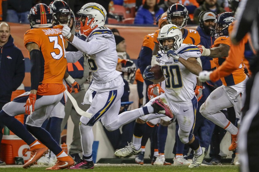 Chargers running back Austin Ekeler makes a cut for a 41-yard run in the fourth quarter against the Broncos.