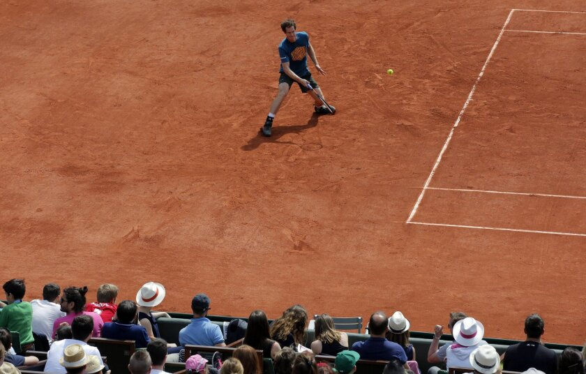 Britain's Andy Murray returns the ball during a training session of the French Open tennis tournament at the Roland Garros stadium, in Paris, Saturday, May 21, 2016 . The French Open starts Sunday May 22. (AP Photo/Christophe Ena)