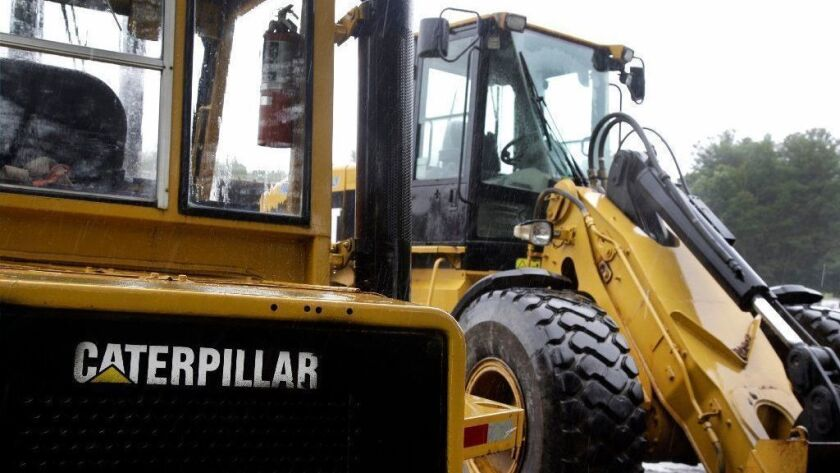 Caterpillar loaders are parked in Middleton, Mass., in 2017. Caterpillar reported financial results Jan. 28, 2019, and missed fourth-quarter profit expectations.