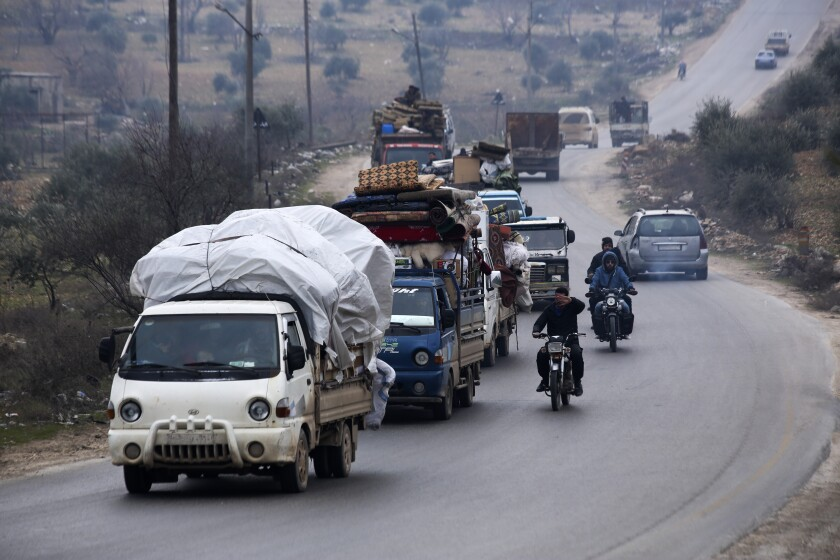 Syrians flee the town of Mastouma on Jan. 28 during a government offensive.