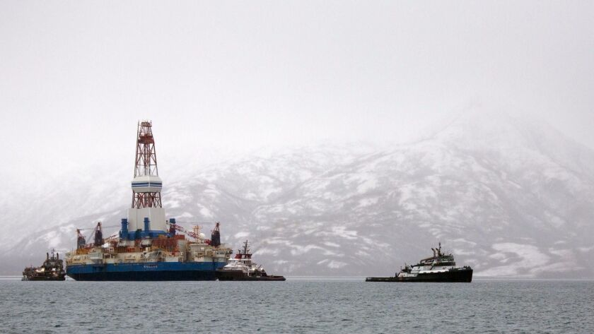 Salvage teams conduct an assessment of Shell's Kulluk drill barge on Jan. 9, 2013, in Kodiak Island'