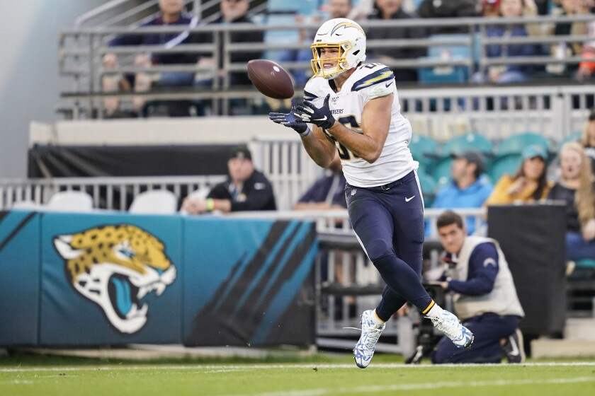 Chargers tight end Hunter Henry catches a pass for a touchdown during the second quarter of a game against the Jacksonville Jaguars last season.