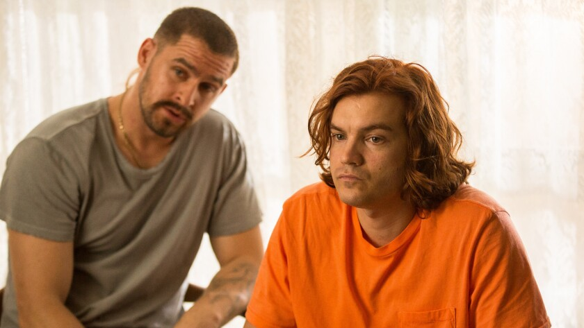 "Jack Kesy, left, and Emile Hirsch in the movie ""Peel."""