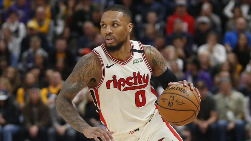 """Portland Trail Blazers guard Damian Lillard is one of the cover athletes for the """"NBA2K21"""" video game."""
