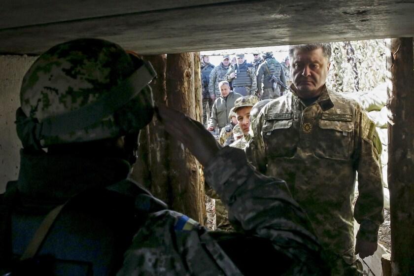 Ukrainian President Petro Poroshenko visits troops on the front line against pro-Russia separatists on Oct. 10 in Kurahovo, in the Donetsk region.