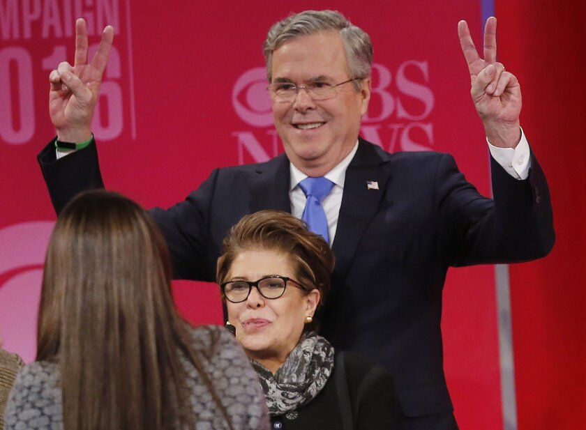 Republican presidential candidate, former Florida Gov. Jeb Bush poses for a photograph after the CBS News Republican presidential debate at the Peace Center, Saturday, Feb. 13, 2016, in Greenville, S.C. (AP Photo/John Bazemore)
