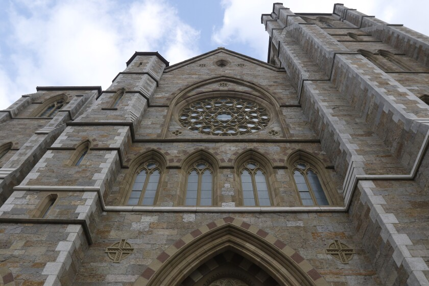This Friday, Jan. 22, 2021, photo shows the Cathedral of the Holy Cross in Boston. Overall, the nearly 200 dioceses in the U.S. and other Catholic institutions received at least $3 billion from the federal government's small business emergency relief program. That makes the Roman Catholic Church perhaps the biggest beneficiary of the paycheck program, according to data the U.S. Small Business Administration released following a public-records lawsuit by AP and other news organizations. (AP Photo/Bill Sikes)