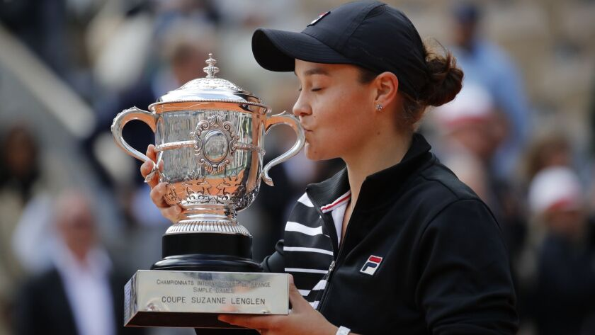 Australia's Ashleigh Barty kisses the trophy as she celebrates winning her women's final match of th