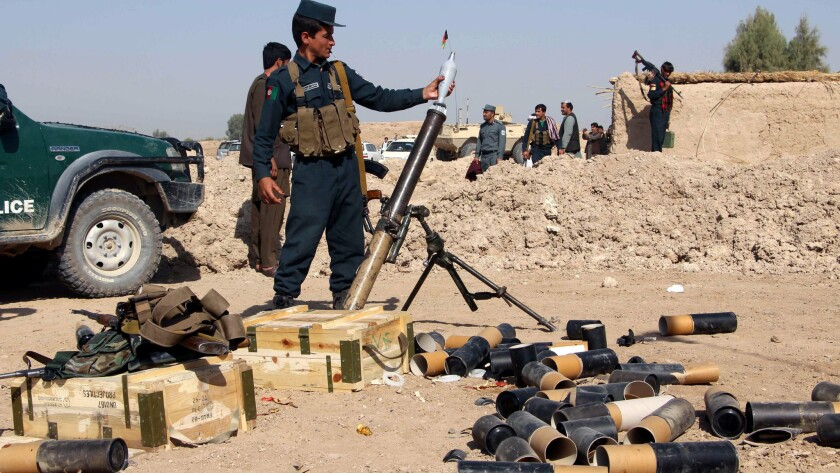 An Afghan security official prepares a mortar launcher during an operation against Taliban militants in Helmand province on Oct. 22, 2016.