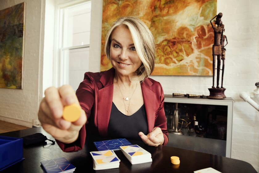 """Psychotherapist Esther Perel at her Manhattan home with her new board game, """"Where Should We Begin."""""""
