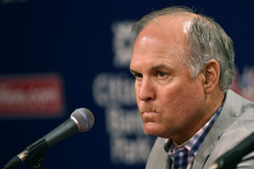 Former Philadelphia Phillies manager Ryne Sandberg pauses during a news conference where he announced his resignation before a baseball game against the Washington Nationals, Friday, June 26, 2015, in Philadelphia. (AP Photo/Matt Slocum)