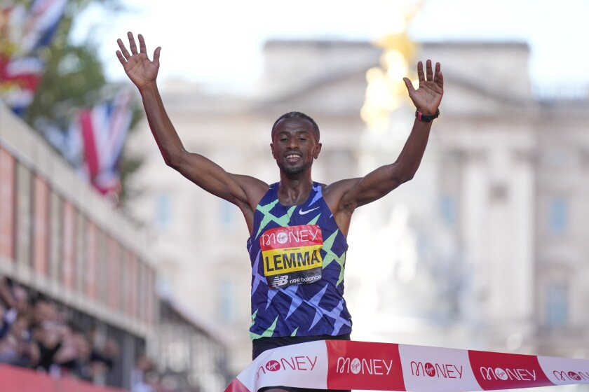Ethiopia's Sisay Lemma crosses the finish line to win the Men's race in the London Marathon in central London, Sunday, Oct. 3, 2021. (AP Photo/Kirsty Wigglesworth)