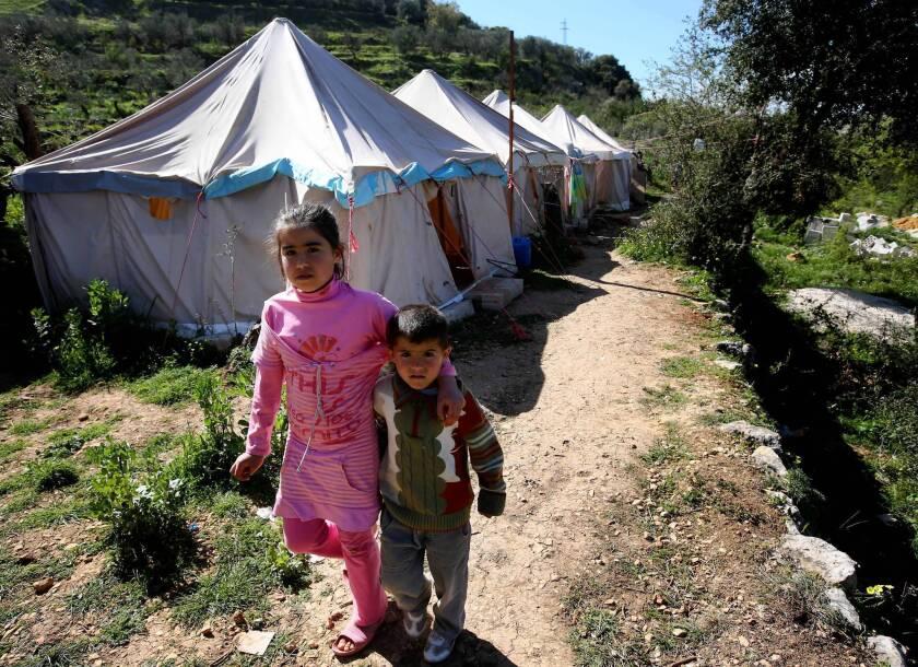 Syrians make their way at a refugee camp in Ketermaya, Lebanon.